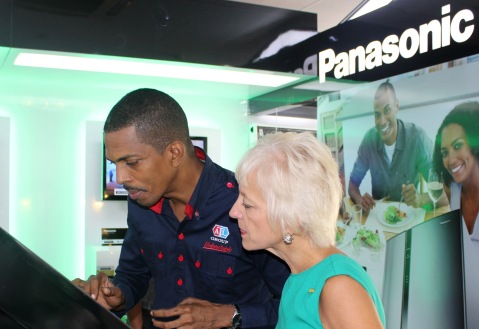General Manager of Appliance Traders Limited (ATL) Ian Neita (right) demonstrates to Kelly Tomblin, head of the Jamaica Public Service Company (JPS) how to navigate the touchscreen Panasonic Eco-Simulator at the launch of ATL's Eco Store in Kingston on Thursday June 6. The ATL Eco-Store is Jamaica's first energy-exclusive retailer and will distribute a range of green electronics including inverter refrigerators and air-conditioners, solar panels as well as LED bulbs.